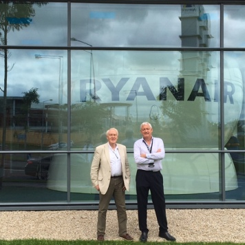 Learmount (L) and Capt Andy O'Shea in front of Ryanair's Dublin training centre, the new Controlled Training simulator visible through the glass